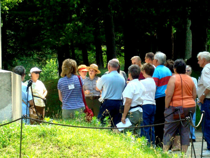 A park ranger talks to a group of people.