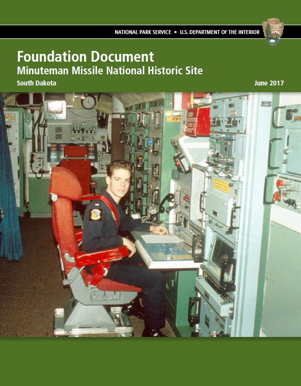Green booklet cover with title and a historic photograph of a missile officer