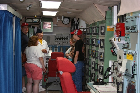 Visitors listen to former missileer Al Martens on an Open House tour