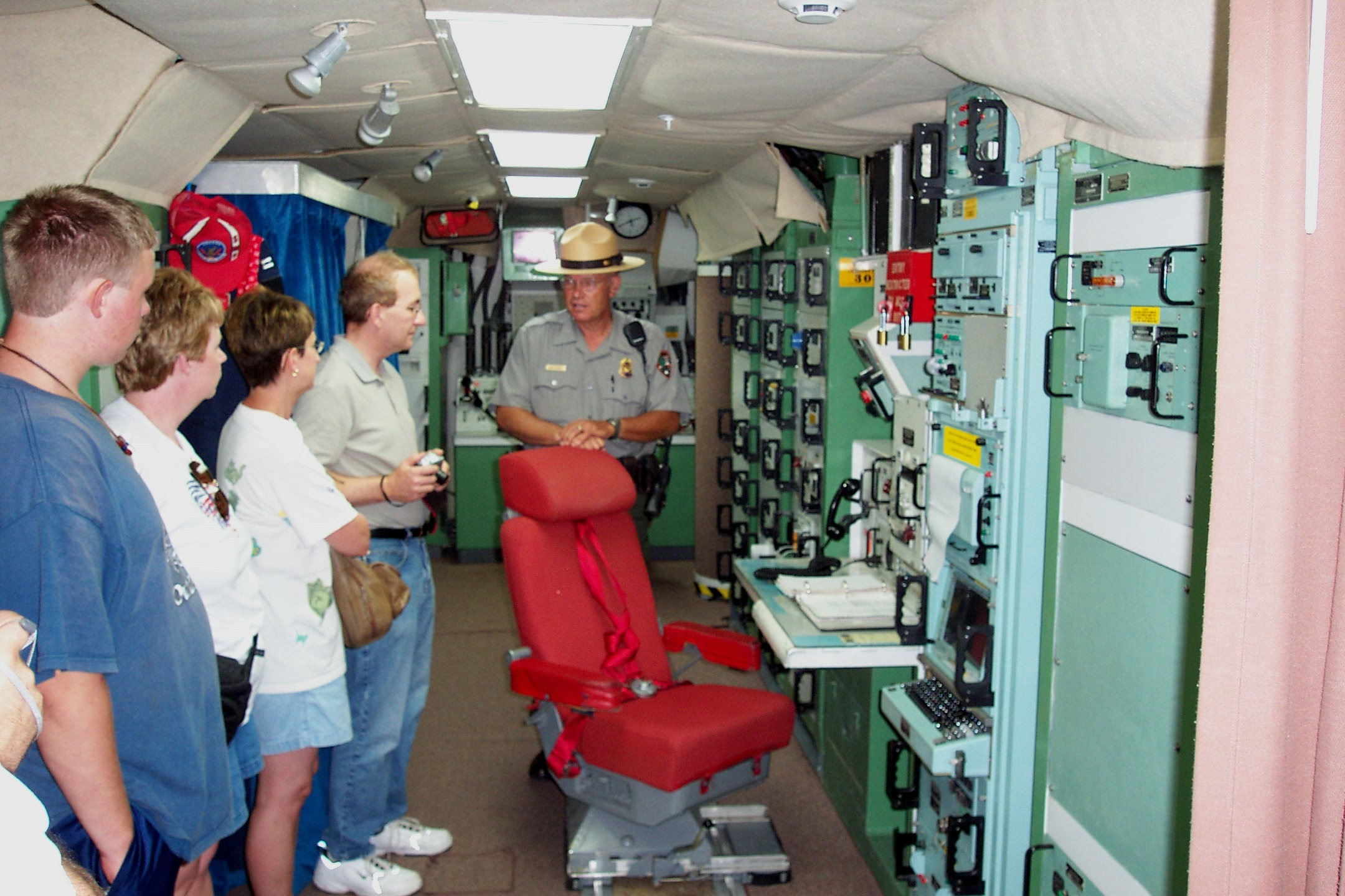 Visitors on a tour in the underground Launch Control Center at Delta-01