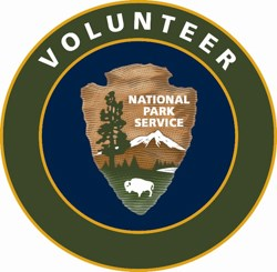 "The VIP logo consisting of the NPS Arrowhead and the word ""Volunteer"" above it."