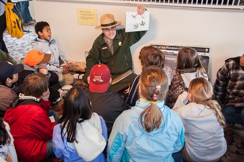 A ranger instructs students.