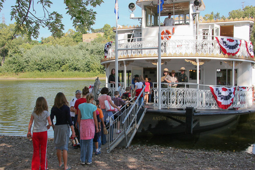 Students boarding a paddleboat.