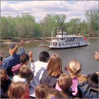 Children waving at Big River Journey event.