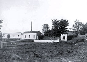 An old black and white photograph of the buildings and resevoir at the Bureau of Mines (Coldwater).