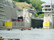 Canoes locking through a dam on the Mississippi River.