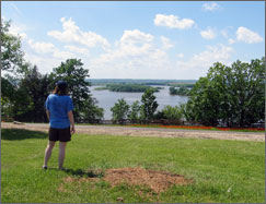 A visitor enjoying a view of the Mississippi River from Schaars Bluff.
