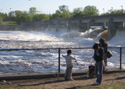 Water spills over the watergates of a dam on the Mississippi River.