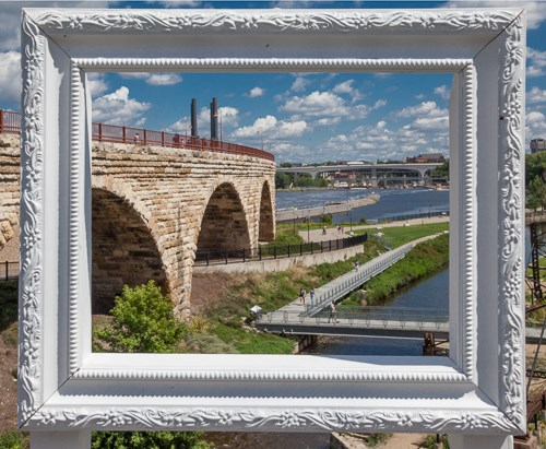 A picture frame frames an old bridge.