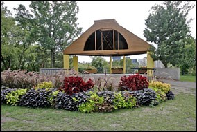 Flowers frame a gazebo in the background at Father Hennepin Bluffs Park.