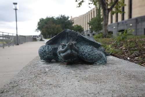 A small bronze statue of a snapping turtle.