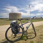 A bicycle sits in front of the stone round tour at Historic Fort Snelling.