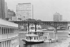 Old picture of the classic boats that set sail off the Harriet Island.