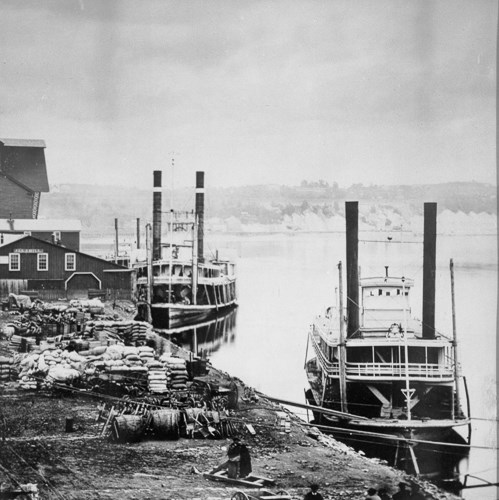 Historic steamboats along the banks of the Mississippi River.