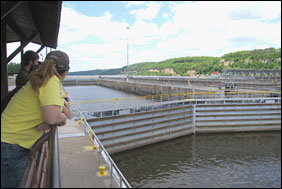 A visitor views the lock at Lock and Dam 2 on the Mississippi River.