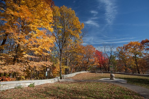 Fall colors brighten a walking trail in the park