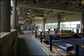 Interior of the Minnesota Valley National Wildlife Refuge Visitor Center showing exhibits and sitting area.