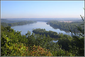 The island-dotted Mississippi River flows past forested banks and into the distance.