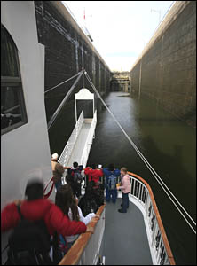 Children on an excursion boat watch their ship enter the locks.