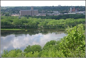 From high on a bluff, one can see views of the Mississippi River and wooded shorelines.