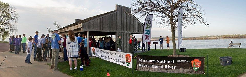 Volunteers gather for the start of the annual Missouri River Cleanup.