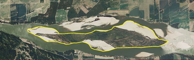 Aerial view directly over the Missouri River and Goat Island with the island outlined in yellow.