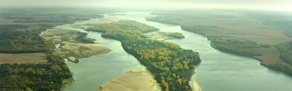 Aerial view over the Missouri River and Goat Island in early autumn.