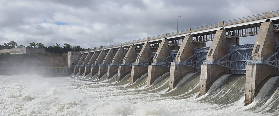 Large volumes of water flow out the gates of the Gavins Point Dam.