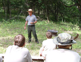 Ranger talks to a scout group about outdoor ethics.