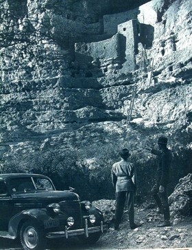 Park Ranger Earl Jackson assisting a visitor to Montezuma Castle in the 1940's.