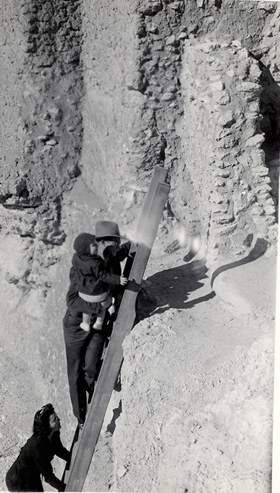 Visitors climbing the ladder into Montezuma Castle in the 1940's.