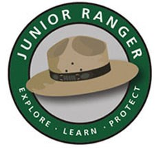 "A ranger's hat surrounded by the words ""Junior Ranger Explore Learn Protect"""