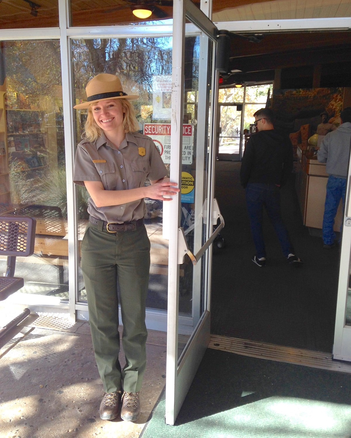 Ranger Kathryn holding the door open at the visitor center