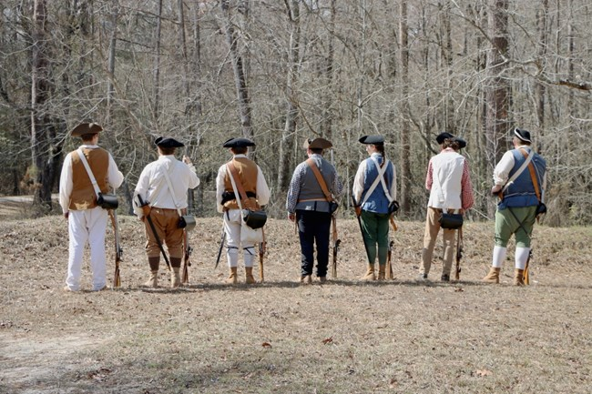 The Wilmington District Minutemen line up and prepare for a musket demonstration during the 241st Anniversary of the Battle of Moores Creek Bridge