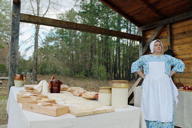 A Living Historian Oversees a Bread Baking Operation during the 241st Anniversary of the Battle of Moores Creek Bridge