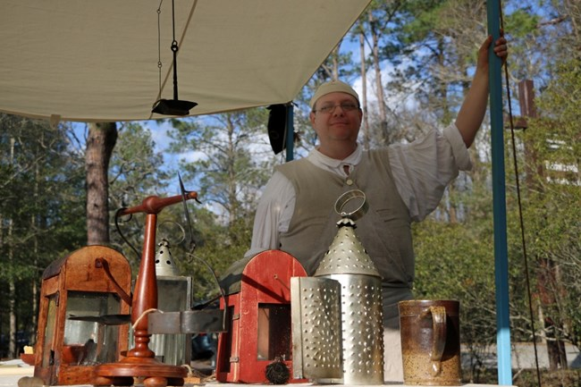 A Candlemaker stands in front of his wares during the 241st Anniversary of the Battle of Moores Creek Bridge