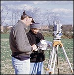 Monocacy archeologists conduct a survey using a total station.