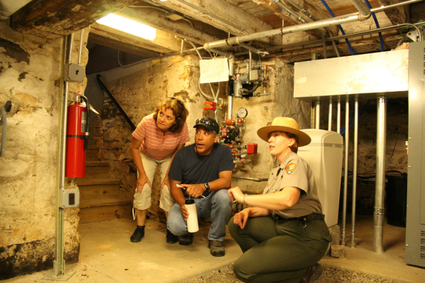 Park Ranger conducting a tour of the Thomas House