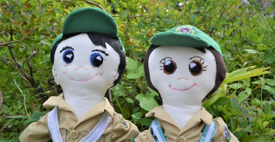 Meadow Rover puppets pose in the bushes.