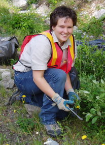 A volunteer helps with exotic plant removal