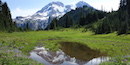 Mount Rainier reflects in a subalpine tarn in Klapatche Park.