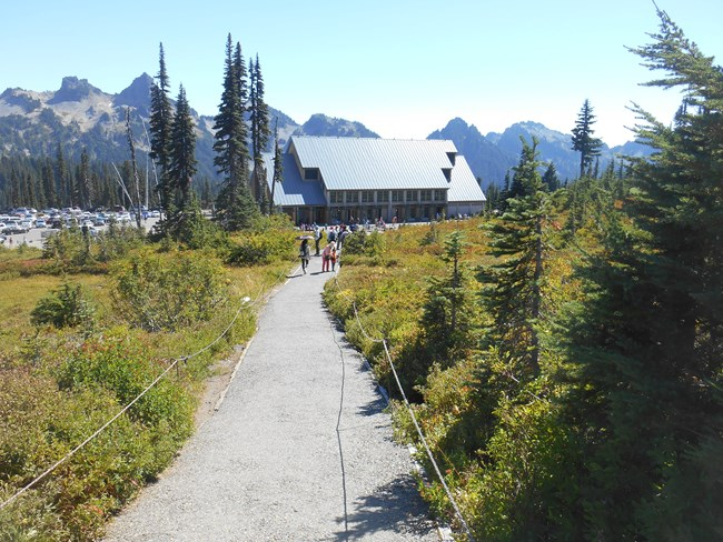 Looking down the trail at the second Jackson Visitor Center and Tatoosh Mountains.