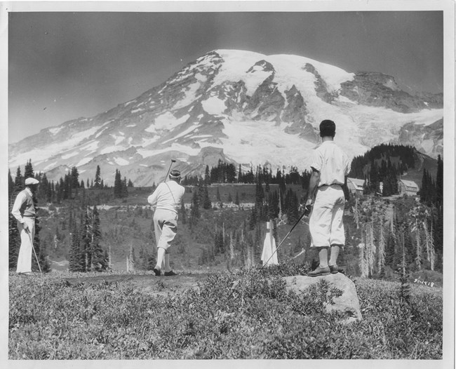 Golfers tee off at Paradise with Mount Rainier in the background.