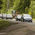 Vehicles traveling through road construction areas on the Nisqually to Longmire road.