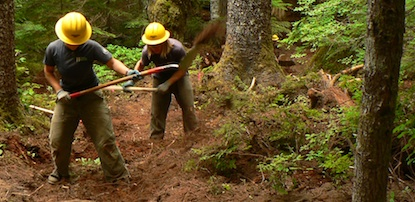 Two SCA (Student Conservation Association) Volunteers shoveling a trail at Mount Rainier.