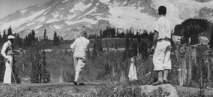 Historic photo of several golfers on the former Mount Rainier golf course in the Paradise Valley.