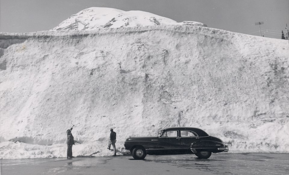 839fdb4e0f97f9 Black and white photo of two men standing next to an old car looking up at  Early park visitors marvel at a snow bank at Paradise, with Mount Rainier  ...