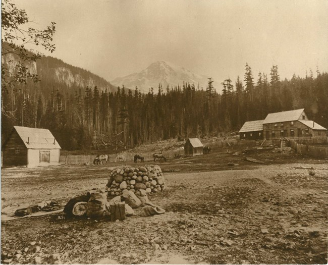 Rustic building in meadow with Mount Rainier rising in the background