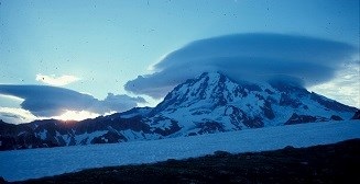 Sunrise filtering though the lenticular clouds on Mount Rainier.
