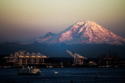 The massive hulk of the highest volcano in the contiguous states, Mount Rainier, dominates the eastern skyline for much of the Puget Sound region.
